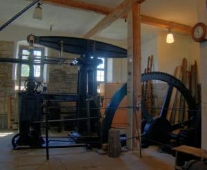 Plútó a Bak csillagjegyben James Watt gőzgépe Artemisz Asztrológia Iskola Debrecen